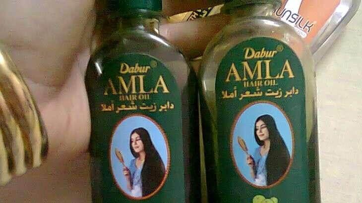 صورة زيت دابر املا الاخضر لتطويل الشعر , متفوتيش زيوت مفيدة لشعرك